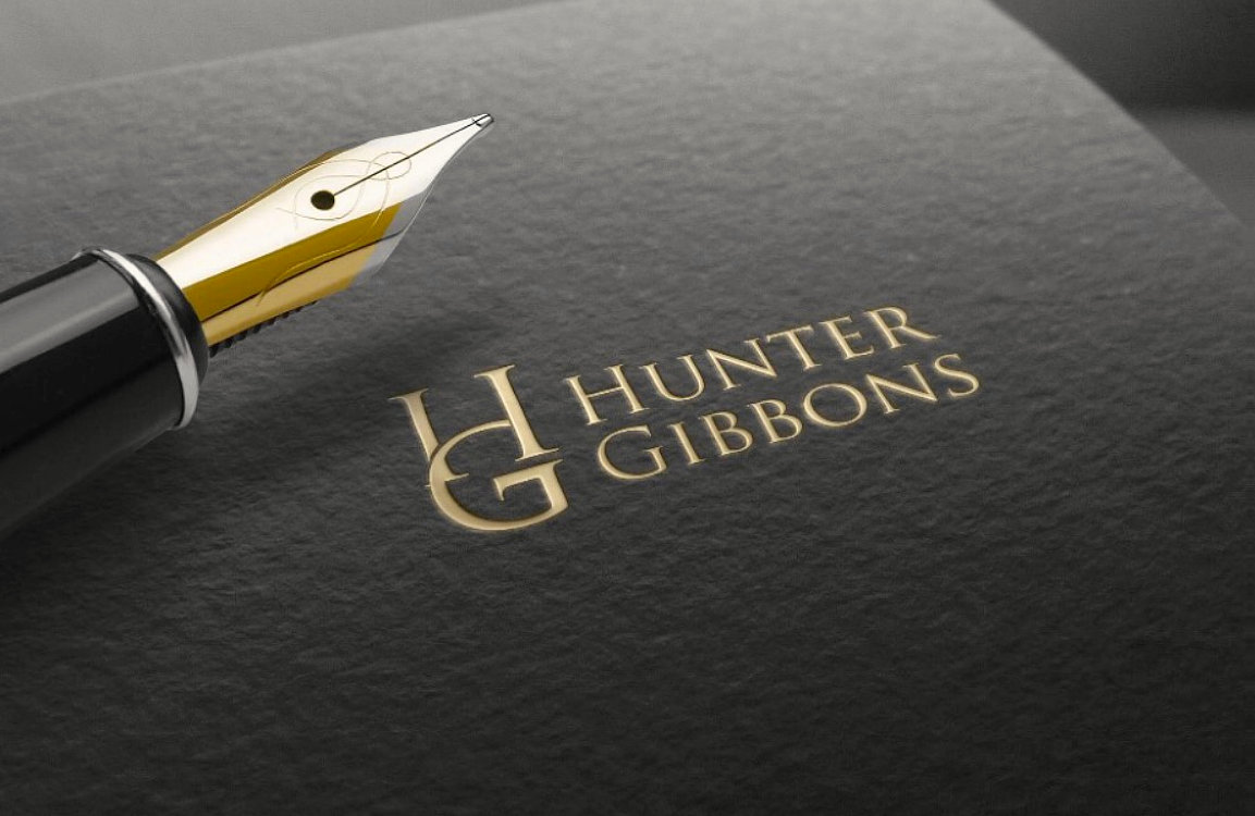 pen and notebook with brand name hunter gibbons